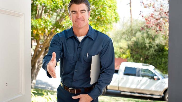 handsome silver fox restoration carpet cleaner client shaking hands meeting Good looking repairman in uniform and clipboard reaching for a handshake. client retention guide